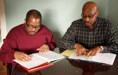 """EVERYDAY IMPACT Carl Johnson is determined to reach his ultimate goal of getting his GED, but is pleased with his achievements along the way. Carl sees progress after working with Volunteer Tutor Patrick Lewis. """"My reading is improving. I see things differently, like signs, and I can read my mail better now, too,"""" says Carl. Patrick finds working with Carl very rewarding: """"Helping others achieve their personal goals has given me an immense sense of accomplishment."""""""