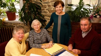 """VOLUNTEER TUTORS CHANGE LIVES Volunteers Pat Paul, Sandy Kauffman, Barbara Sheehan, and Jack Stoddard work together to tutor adults who need help with reading, writing, and math. All four are retired and meet with their students twice a week. """"Our sessions are often filled with good cheer and laughter,"""" says Jack. Pat adds, """"Working with such selfless tutors and dedicated students makes me look forward to coming every week."""""""