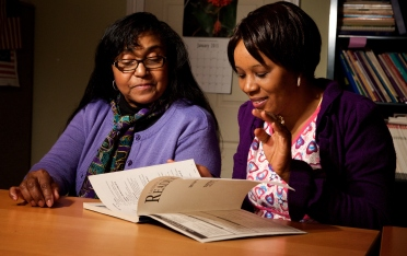 """LEARNING TO BUILD A NEW LIFE Civil war in Liberia caused Madoussou Fofana to leave her country and immigrate to the U.S. Madoussou hopes to build on her current work as a caregiver and eventually become a licensed nurse. With help from Volunteer Tutor Barbara Demps, Madoussou is improving her reading and writing and recently passed the U.S. citizenship test. Barbara especially enjoys teaching Madoussou reading, saying, """"I love to read and I wanted someone else to realize how rewarding it is."""""""