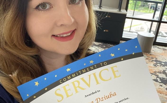 Ann Dziuba Accepts Award