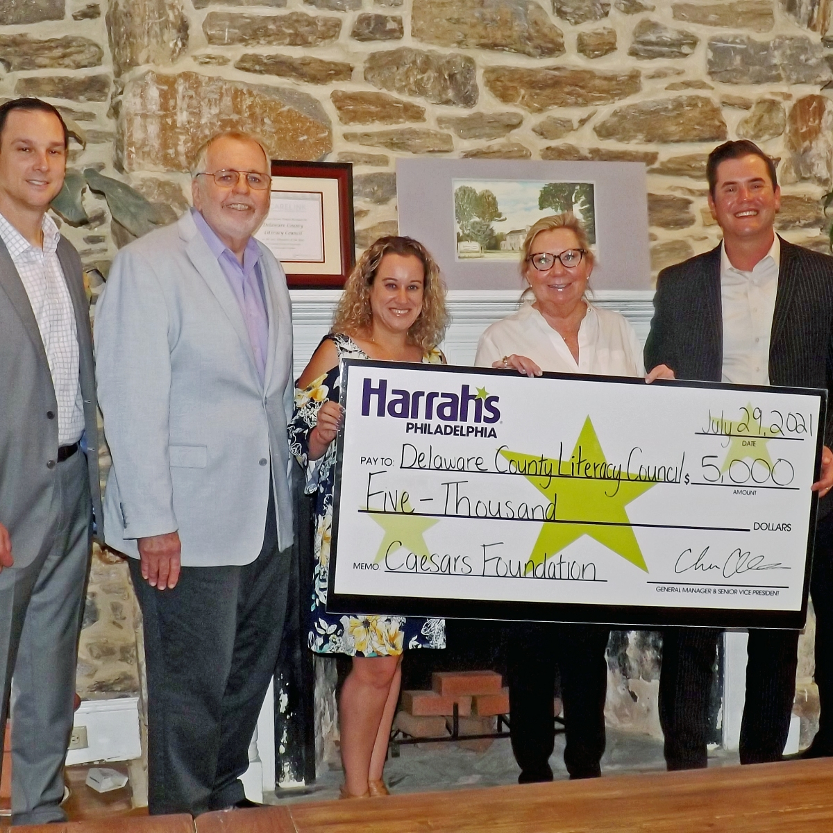 Harrahs and DCLC staff with check